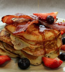 US Pancake Stack with crisp bacon, blueberries, strawberries & maple syrup